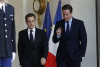 67271_britain-s-prime-minister-cameron-speaks-with-france-s-president-sarkozy-at-the-elysee-palace-in-paris